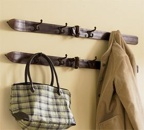 iron hooks on an old pair of children's skis for a coat hook.  Ingenious entry idea!