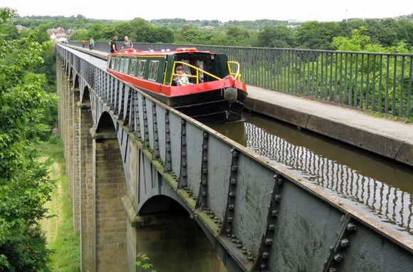 Pontcysyllte Aqueduct & Llangollen Canal, Wales    A few miles east of Llangollen, Wales, the world's longest and highest cast-iron aqueduct is like a theme-park log ride on stilts. The World Heritage site, built in 1805, still gives passengers the ride of their lives. Pontcysyllte carries more than 1,000 canal boats per year across a 1,000-foot span 126 feet above the River Dee. You can take a canal boat or walk across the aqueduct on a towpath. Passengers often admit to feeling queasy as…