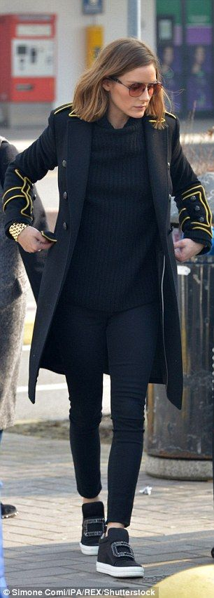 Olivia Palermo - Airport chic: The New York-born 31-year-old wore her wavy blonde hair down and had wrapped herself in an elegant black coat with yellow embroider at the shoulders - February 2018