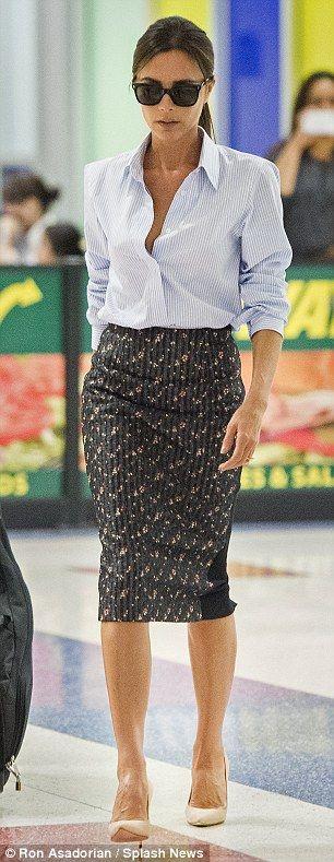 Victoria Beckham stuns in slinky corporate attire as she jets into JFK