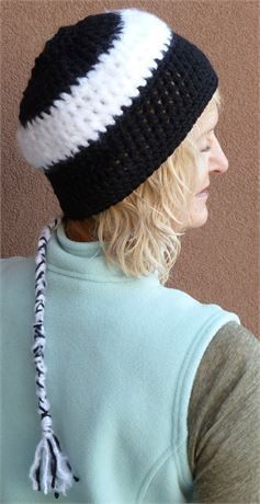 Colorado ski accessories. Its a ponytail hat with a tail. Thats right, your ponytail goes right through the hole and then there is a cute tail that hangs from the hat. If you choose, you can just leave the hat tail inside the hat. This cute black and white ski accessory is made for winter wear no matter your activity. Incredibly comfortable and warm. My hats are all unique in that there is no pattern, just creative talent. The hat will not be duplicated. My hats are designer hats. The hat…