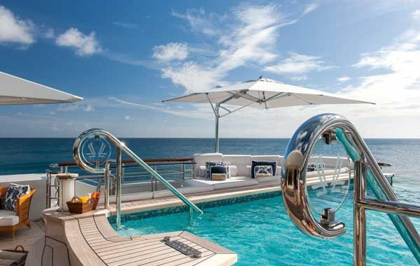 Superyacht Quatroelle has a massive infinity pool - with an artificial counter-current and a full dive station - that appears to drop off directly into the ocean.