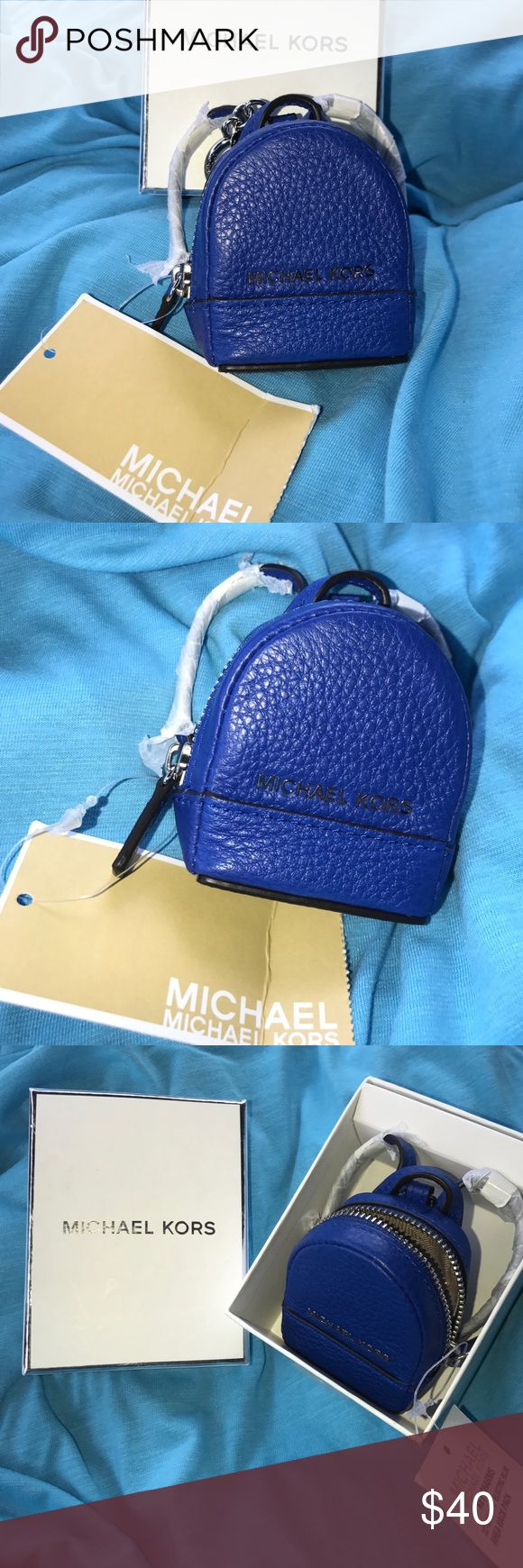 🔥MICHAEL KORS back pack key chain, NWT coin purse 💖NWT brand new MICHAEL KORS very pretty blue keychain backpack, coin purse or other small items, very nice, IT IS AUTHENTIC, box isn't included but it will be wrapped very nicely💖🐱🚬🏡💖make offers through the make offer feature, I will be happy to answer any questions💖and I am accepting reasonable offers 💖 Michael Kors Bags Mini Bags