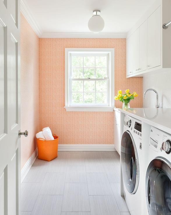 white and orange laundry room design