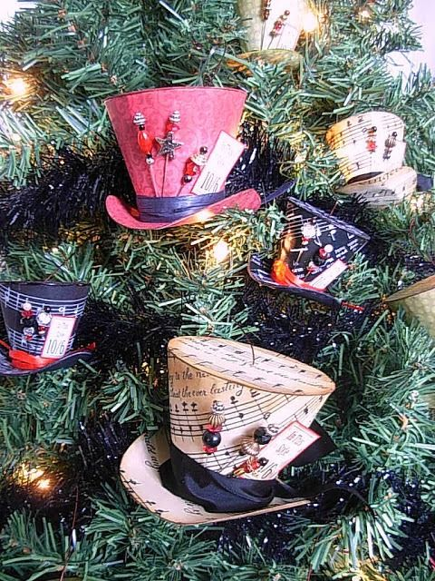 DIY Mad Hatter Hats Tutorial, Template, and Printable Paper from Seeing Things here. This was one of my favorite sites at Halloween with great altered books and whimsical paper shoes.