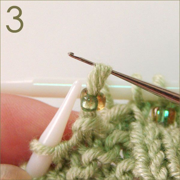 How to add beads on to your knitting tutorial: With a crochet hook that is small enough to fit through your beads, slip one bead onto hook. Slip the next stitch on the left hand needle to the crochet hook and off the needle. Slip bead from crochet hook over the stitch. Return slipped st back to the left-hand needle. Knit the beaded stitch.