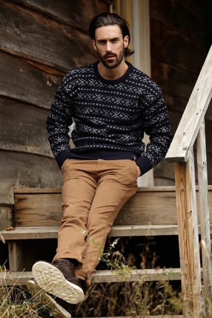 For an everyday outfit that is full of character and personality marry a black fair isle crew-neck jumper with brown chinos. Dark brown leather boots will add elegance to an otherwise simple look.  Shop this look for $136:  http://lookastic.com/men/looks/black-fair-isle-crew-neck-sweater-brown-chinos-dark-brown-leather-boots/6678  — Black Fair Isle Crew-neck Sweater  — Brown Chinos  — Dark Brown Leather Boots