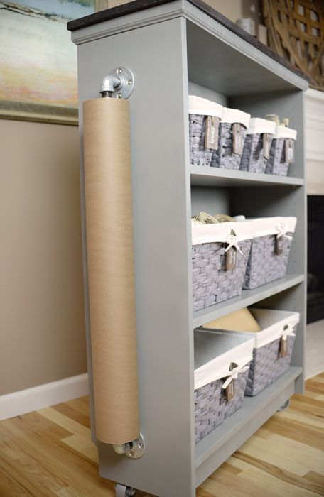 Ikea Furniture Hack: Turn a Billy Bookcase into a Rolling craft cart. Add kraft paper rolls to sides of cabinets/desk as an alternative. So smart.