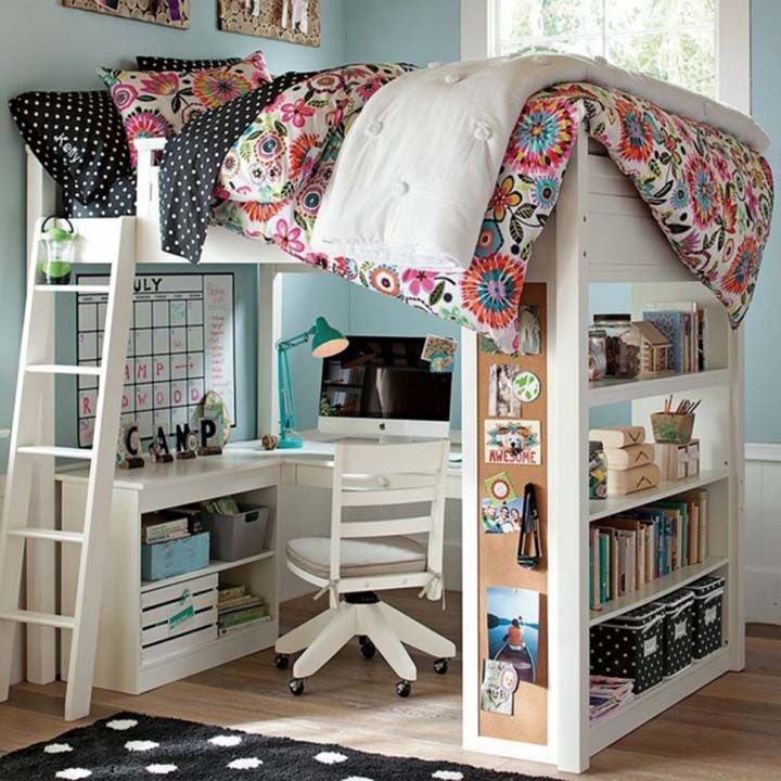 Bed over the children work space with open shelves for storage books