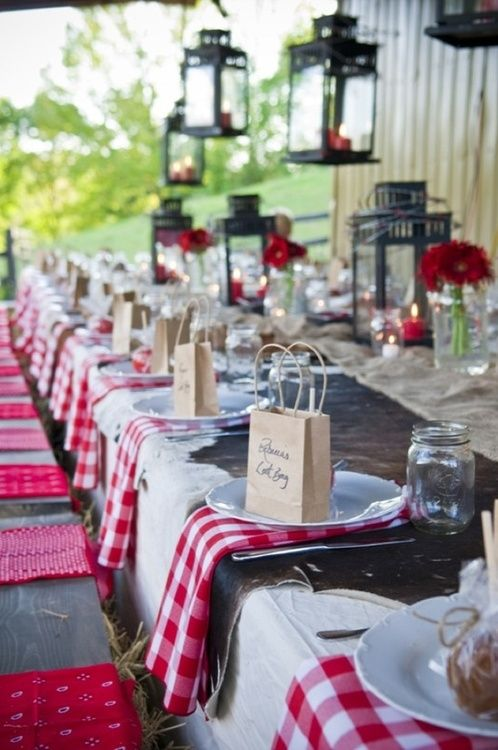 Summer gathering.  Love the bags at each place setting and the lanterns both hanging and set at the table.