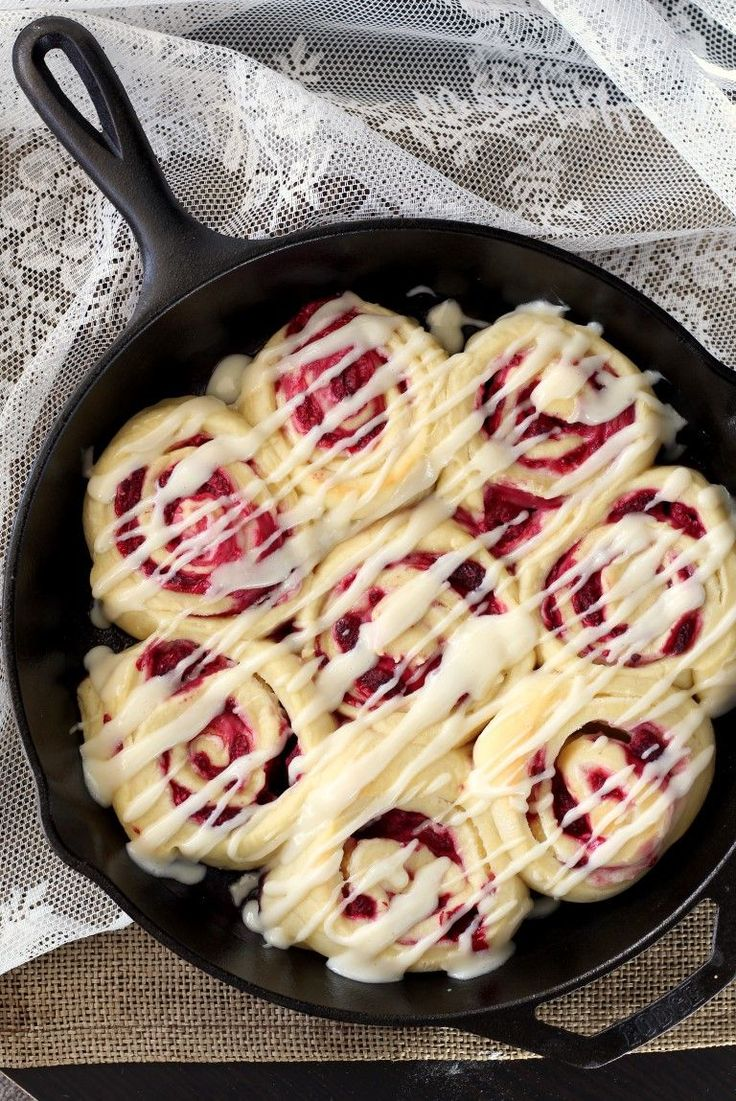 Soft, buttery rolls spread with a cream cheese mixture and stuffed with juicy raspberries. These Raspberry Cream Cheese Sweet Rolls make a special treat. @chocolatewgrace
