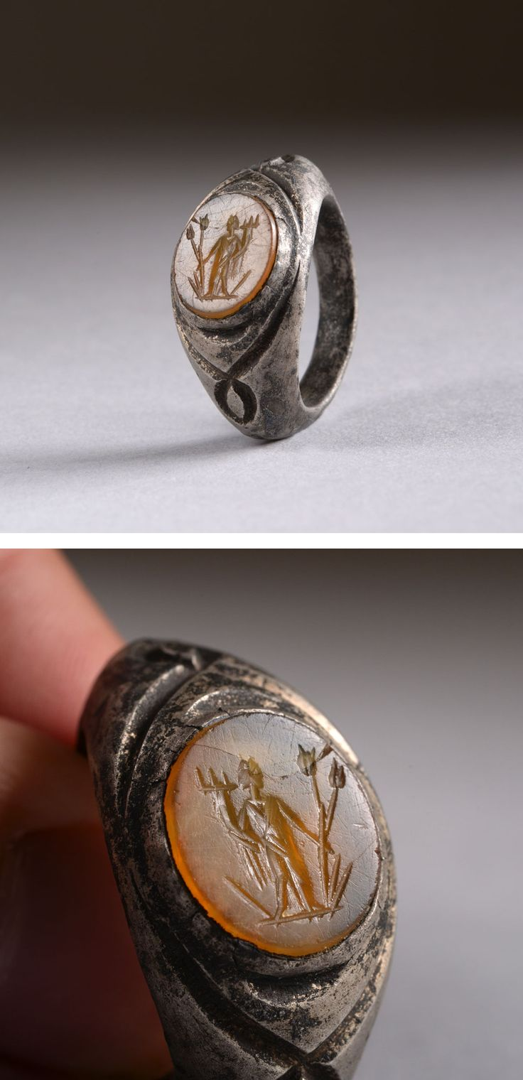 Ancient Roman silver orange intaglio ring depicting the goddess Fortuna, dating to around 150 AD.