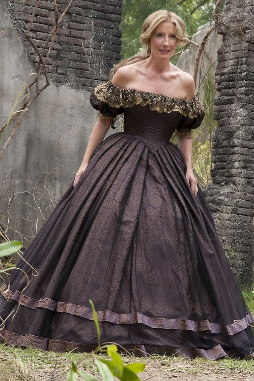 Black, off-the-shoulder, dress inspired by late 19th century finery as worn by Emma Thompson. Still lovely and one of the best actresses of our time.