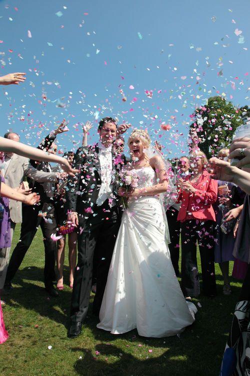 Confetti over the bride and groom