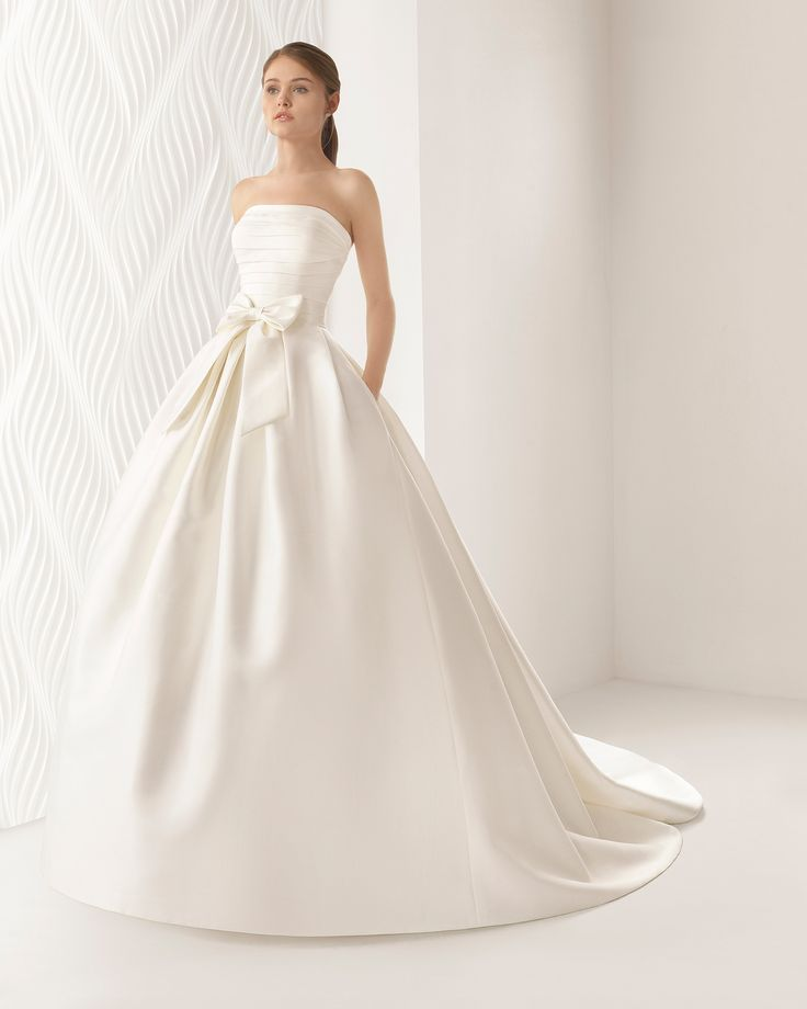 Sophisticated strapless mikado and duchess satin wedding dress that brings out the bride's natural beauty. The pleated neckline really flatters!
