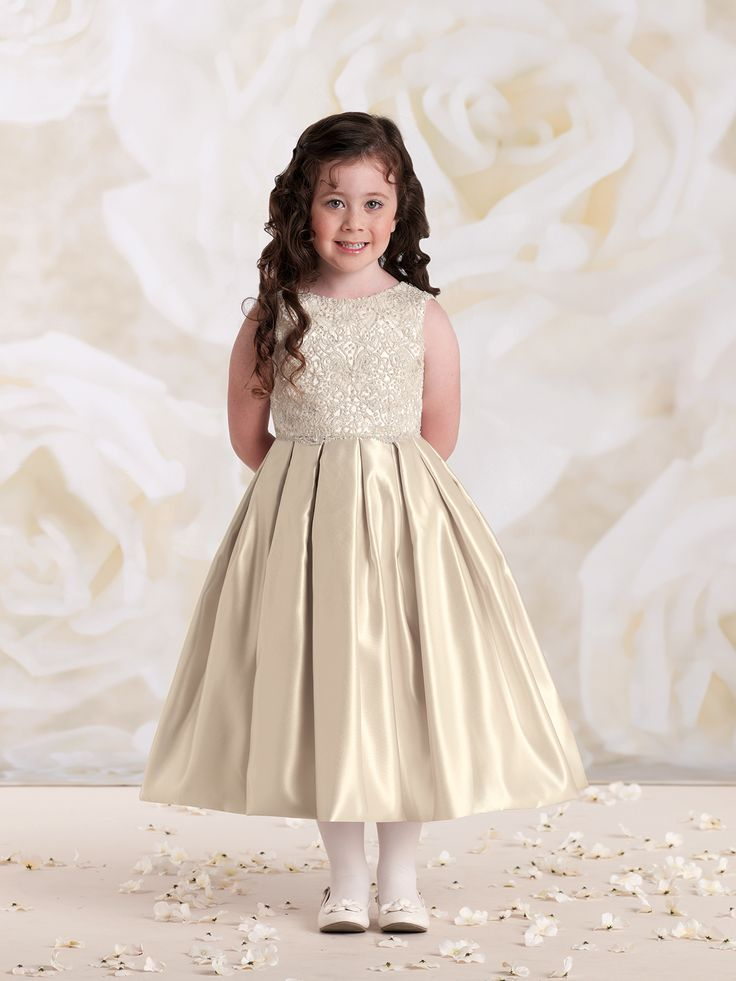 Sleeveless satin and lace tea-length dress, embroidered lace overlay bodice with satin tie back sash, full box pleated skirt. Oyster features metallic lace. Sizes: 2 – 16 Colors: Oyster, Ivory, White