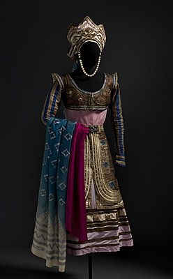 Léon BAKST  designer Belarus (Russia) 1866 – France 1924  France from 1912    Paris  France producer 1909 – 1929    Marie MUELLE  costumier France      Costume for Queen Thamar c.1912  dress: acetate, silk, rayon, cotton, metallic braid, lamé, metal medallions, elastic; overskirt: silk, rayon, cotton, lamé, metallic braid, metal buckle, imitation turquoise; cropped vest: silk, lamé, metallic braid, metal medallions; crown: acetate, cotton, lamé, metallic braid, metal medallions,..