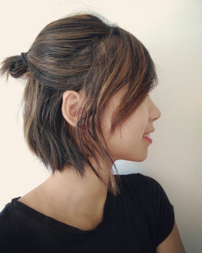 simple pattern of short, square cut with different lengths, asymmetrical pony, small top bun