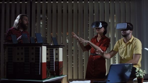 People with VR Helmets in Office