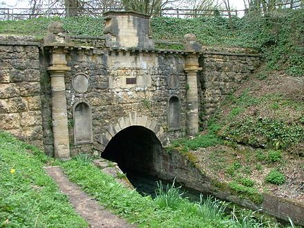 The Sapperton Canal Tunnel is a tunnel on the Thames and Severn Canal near Cirencester in Gloucestershire, England. With a length of 3,817 yards it was the longest canal tunnel, and the longest tunnel of any kind, in England from 1789 to 1811.