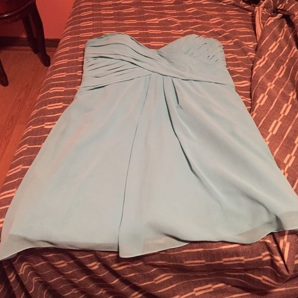 Used Bridesmaid dress! Turquoise bridesmaid dress from David's Bridal, tag says size 24 but that's because I was measured way off, so now I would say it's a size 16/18. Does have a corset back to it so you can adjust it to fit better. Only worn it once and no damage to it. David's Bridal Dresses