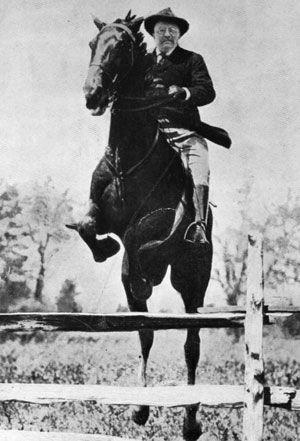 Theodore Roosevelt Jumping Fence with Horse.