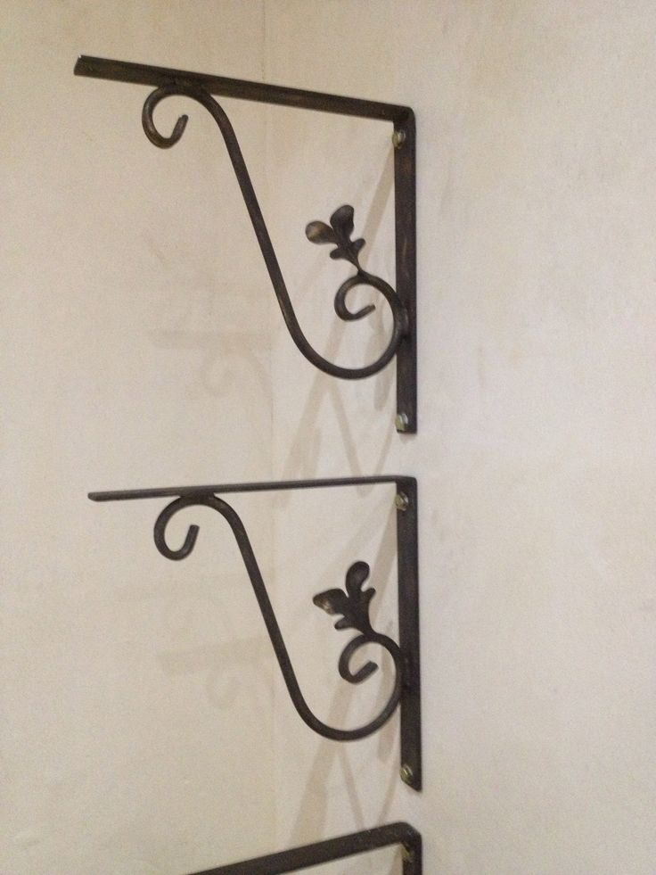 Hand forged iron shelf brackets. We originally wanted floating wooden shelves but could not find a suitable hidden bracket for the weight of the wood so we had these made as a feature instead.