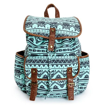 This small size rucksack backpack is designed with a tribal print canvas exterior and contrasting faux leather trims, so you can carry all your necessities and absolute style.