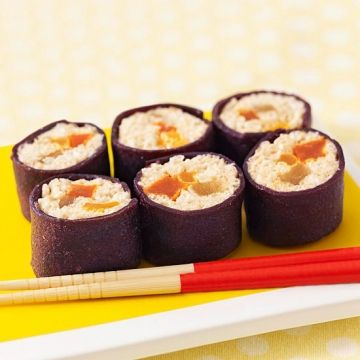 """Something's fishy about this sushi roll -- there's no fish in it! Our recipe for April Fool's turns this Japanese staple into a fruity sensation.                 Make it: In a medium bowl, melt 1 cup mini marshmallows and 1 tablespoon butter in the microwave on High for about 45 seconds. Stir in 2 cups crispy rice cereal. With buttered hands, spread mixture on wax paper to a 12""""x5?"""" rectangle. Place 8 pieces each dried pineapple, papaya, and apricot lengthwise along the middle of the sheet…"""