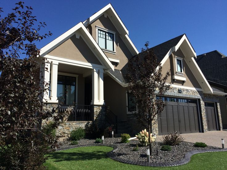 Traditionally inspired Craftsman home with jaw dropping double front columns with natural stone features #architecture #stone #columns #craftsman #coopersairdrie