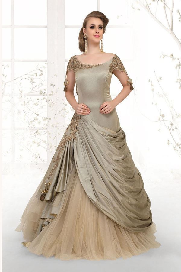 Wear A Palatial Glow In This Outstanding Olive Green Designer Gown Featuring A Wide Round Neck Indian Wedding Gowns Indian Gowns Dresses Designer Evening Gowns