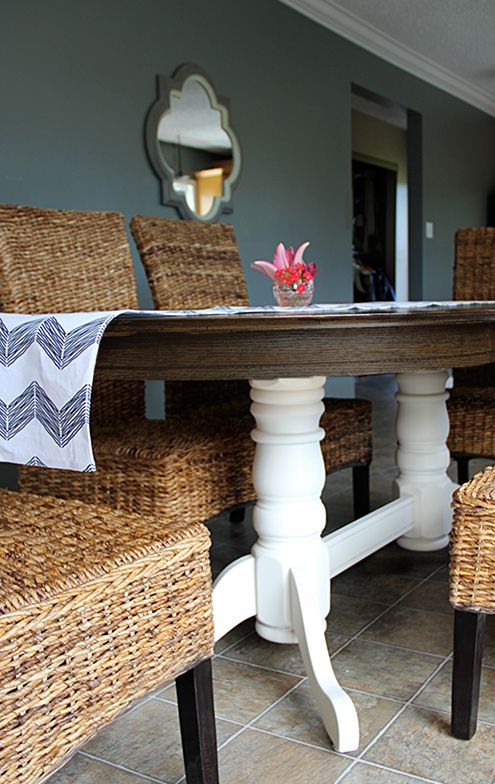 A DIY refinished oak table top makeover, with new stained top and spray-painted base.