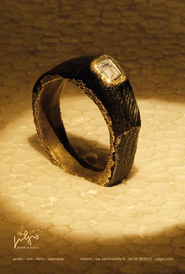 anello. ferro - oro - diamante baguette