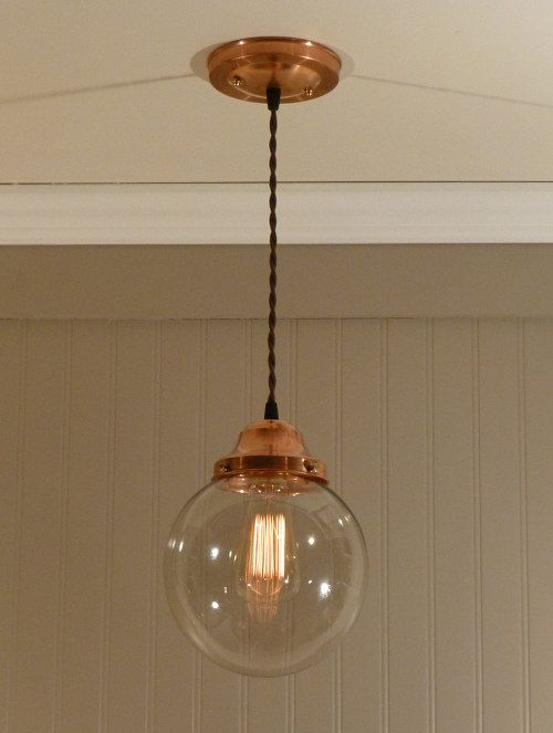 Refurb the bathroom light. A little copper paint, a new lightbulb, and voila!