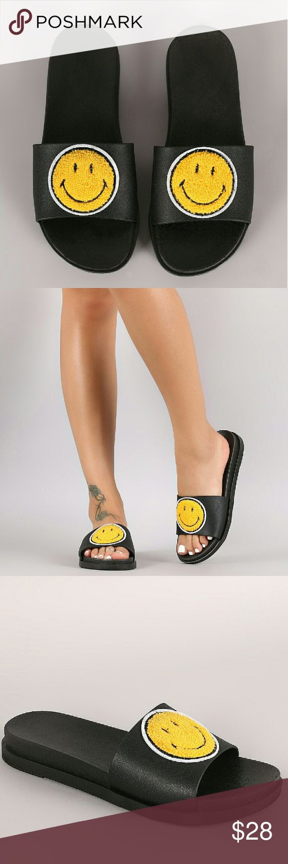 "Emoji Happy Face Slide Sandal DESCRIPTION This chic sandal features an open toe silhouette and wide band across vamp with assorted emoji patches design. Easy slide style.  Material: PVC (man-made) Sole: PVC  MEASUREMENT Heel Height: 1"" w/ 0.75"" Platform (approx)  TRUE SIZE SARAH SIAH  Shoes Sandals"