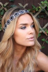 Party hair style, long wavy blonde hair. Headband.