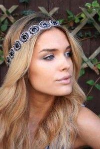 Party hair style, long wavy blonde hair. Headband.