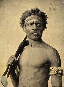 Aboriginal warrior, North Queensland photograph by Henry King (c 1900) The subject holds a shell tipped spear-thrower of the Cape Grenville type, and a boomerang, with the band representing his clan
