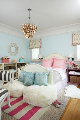 girl's rooms - blue walls ivory wood camel back bed pink ruffled shams silk blue damask pillows tan pink striped rug layered sisal rug white poufs capiz chandelier