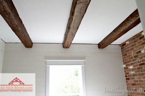 Fake ceiling rafters are a great way to add country character. Blogger Traci of Beneath My Heart used artificial beams to dress up her bathroom and hide an unsightly pipe.  Get the tutorial at Beneath My Heart.