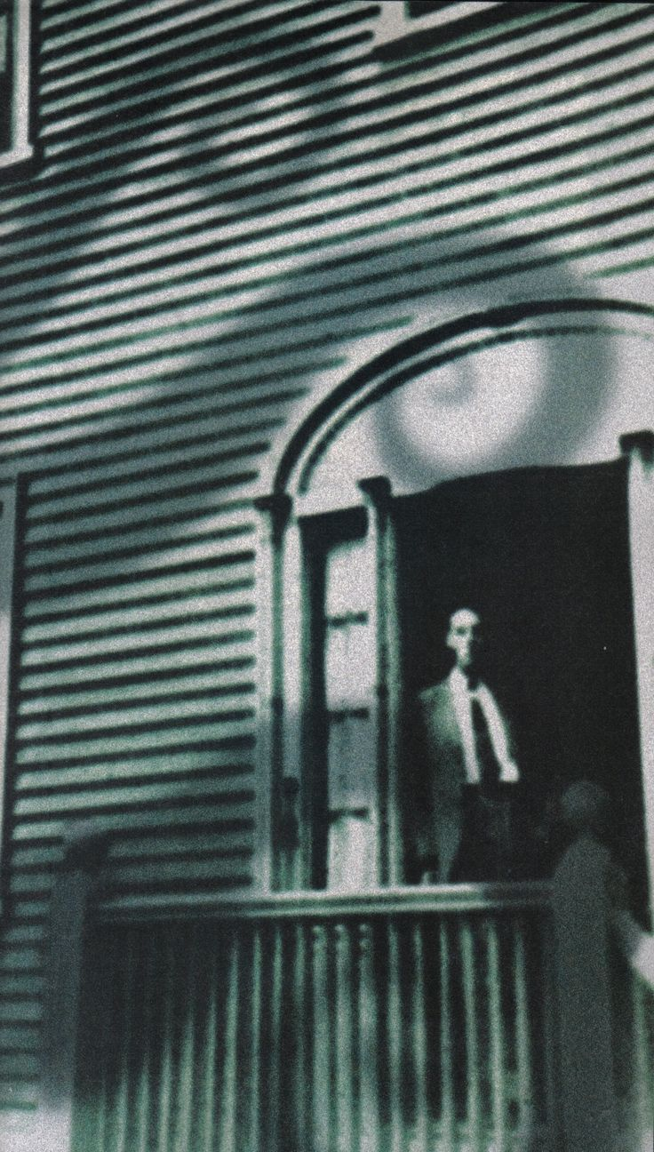 HP Lovecraft in the doorway of his Providence home.