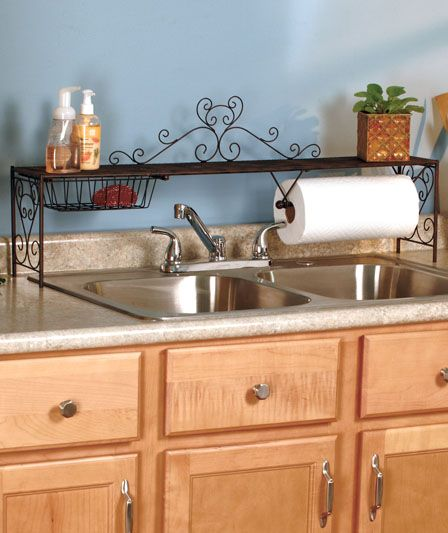 The roomy Over-the-Sink Shelf allows you to maximize your counter top space by providing a multifunctional raised shelf for storing cleaning supplies, plants, herbs and more. It has a built-in wire basket for sponges and a dowel for a roll of paper towels. Only $15!!!  #Organization #Kitchen #Sink