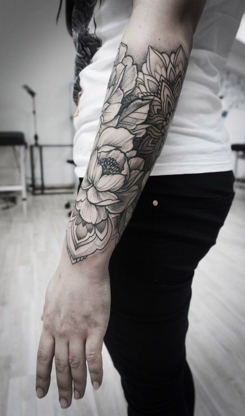 Half sleeve flower tattoo. Click to discover more Sensational Flower Tattoos.