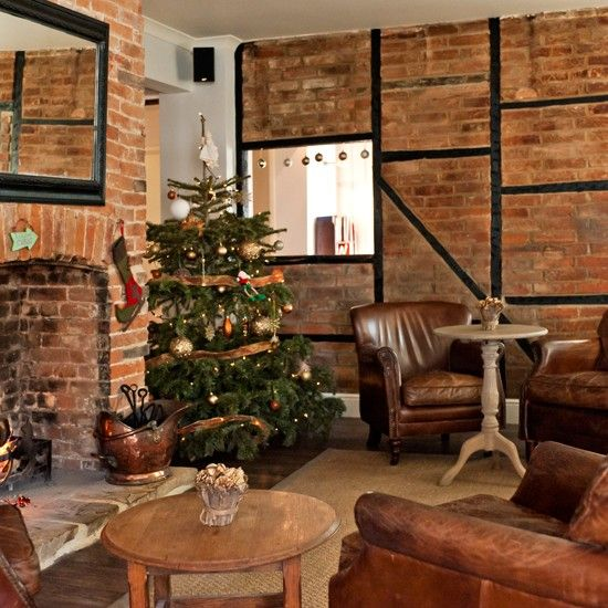 Warm And Cosy Living Room Worn Leather Armchairs Teamed With A Stone  Fireplace Create A Snug