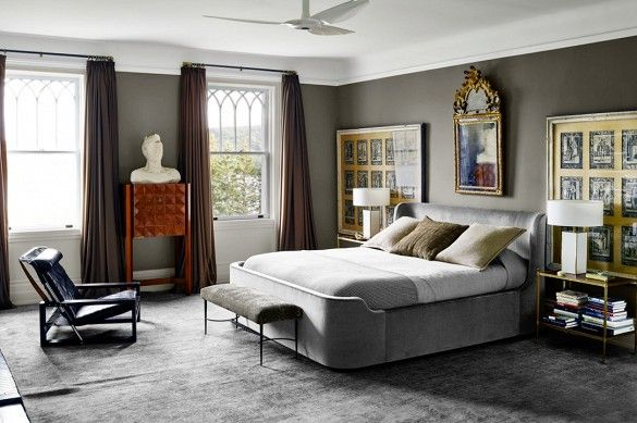 Bedroom With Gray Textiles And Modern Black Chair