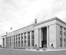 """Cotter Federal Building: Designed in 1930 by the architects Malmfeldt, Adams and Prentice, the William R. Cotter Federal Building was one of the first buildings constructed during the ambitious public works program generated by the Depression. The exterior was designed in the architectural style known as """"Starved Classicism,"""" which spanned the narrow line between classicism and modernism, a characteristic of public buildings of the period."""