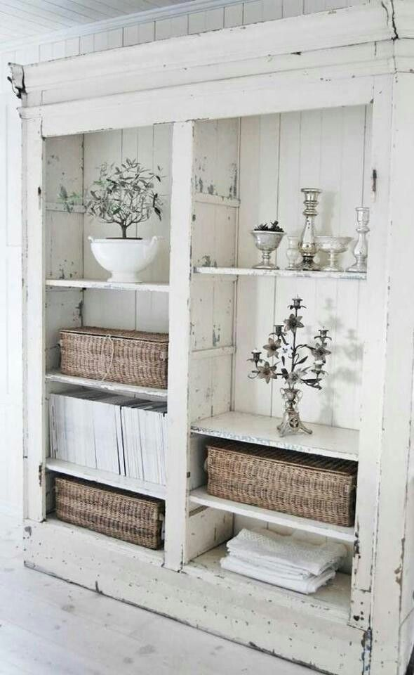 Love simple, distressed white storage furniture.  White vintage shabby chic shelving unit.