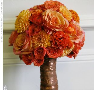 Brooke loves spring flowers like peonies and anemones, but September wasn't the right time of year. Instead she carried dahlias, spray roses, coxcomb, and ranunculus. Her bouquet was wrapped in brown ribbon and copper wire.