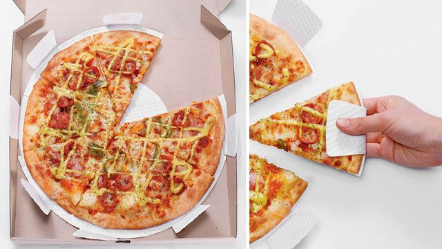 Mini paper plates underneath your pizza, with tabs to help pull the slices out of the box. Genius!