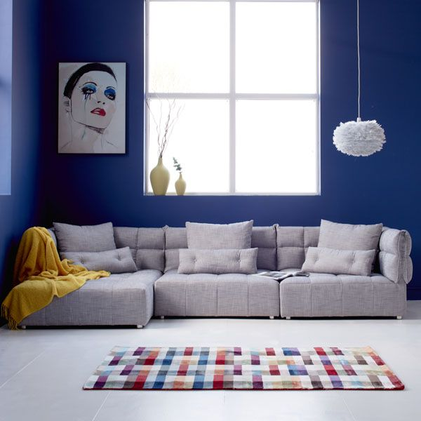 The graphic lines and array of almost 30 colours in this fantastic rug is sure to add the wow factor to your living space. Beautifully made and super soft underfoot, it's a real design defining statement.